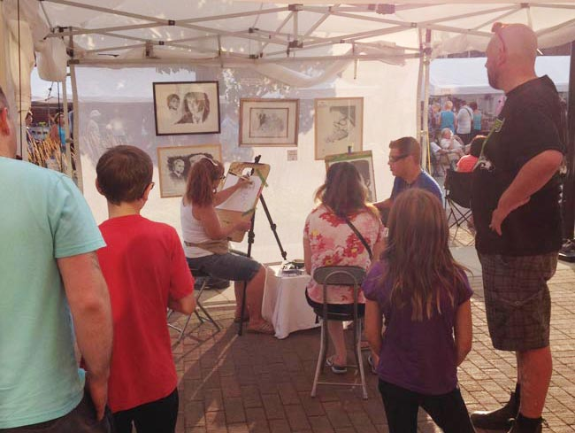 Drawing a crowd at caricature drawing booth