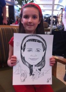 Caricature of little girl drawing with her cat at Georgian Mall in Barrie