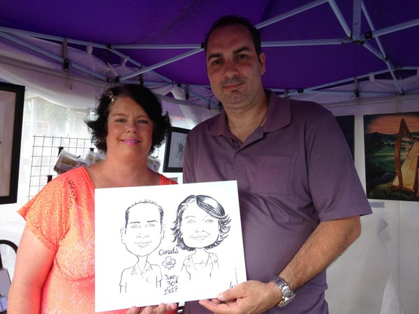 Couple with their caricature at Barrie's Promenade Days, 2017